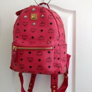 MCM studded pink backpack